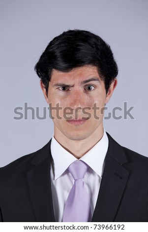 Young businessman with a suspicious look - stock photo