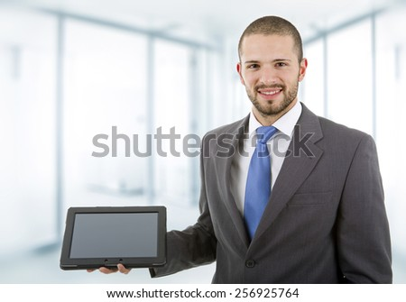 young businessman with a tablet pc, at the office - stock photo