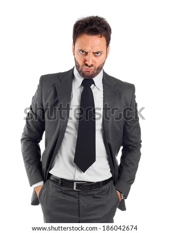 Young businessman with angry expression on white background.