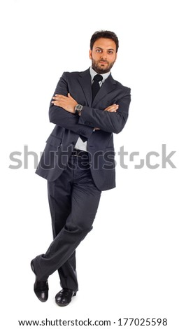 Young businessman with arms crossed on white background