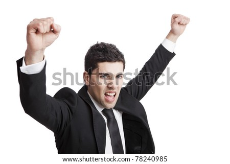 Young businessman with arms up isolated over a white background