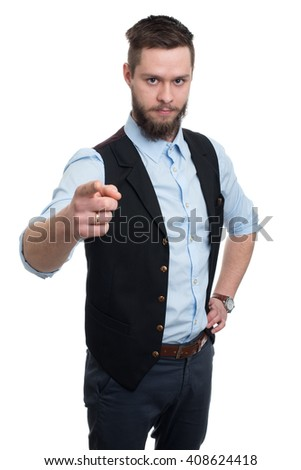 Young businessman with beard on white background. Handsome businessman seriously looking and pointing at camera
