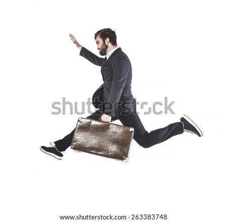 Young businessman with beard, running with big old suitcase. isolated on white. - stock photo