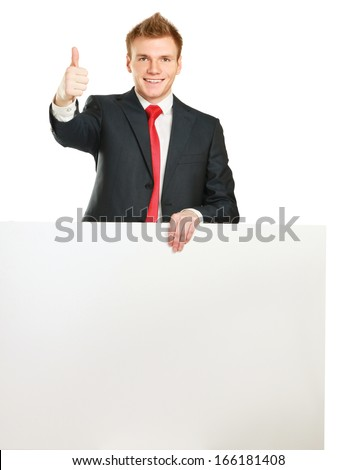Young businessman with blank board showing thumb up isolated on white background - stock photo
