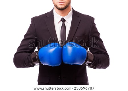 young businessman with boxing gloves ready for battle