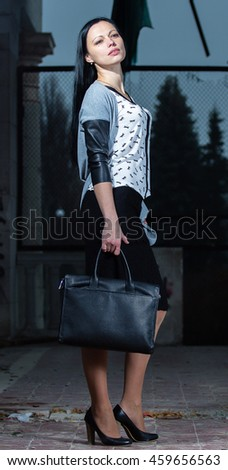 Young businessman with briefcase in the old building