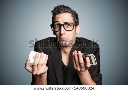 Young businessman with broken smartphone. - stock photo