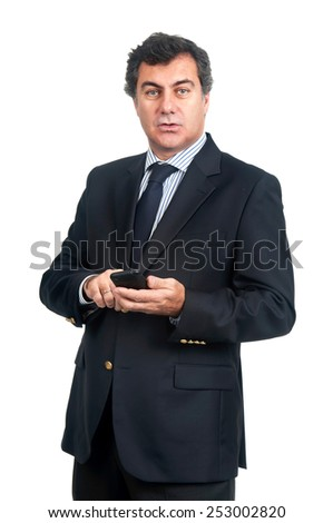 Young businessman with cellphone isolated in white - stock photo