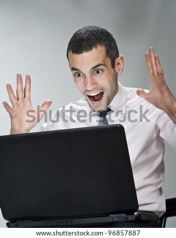 Young businessman with computer - stock photo