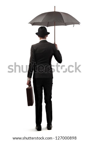 young businessman with elegant dress and umbrella - stock photo