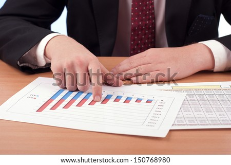 Young businessman with financial documents  - stock photo