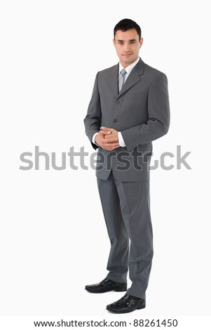 Young businessman with hands folded against a white background