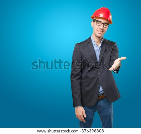 Young businessman with handshake gesture