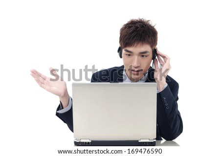 Young businessman with headphones and laptop on help center - stock photo
