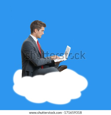 young businessman with laptop computer sitting on a cloud symbolizing cloud computing - stock photo