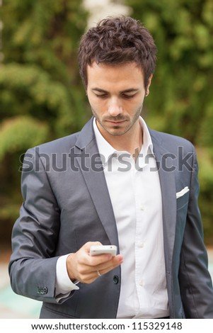 Young Businessman  with Mobile Phone - stock photo
