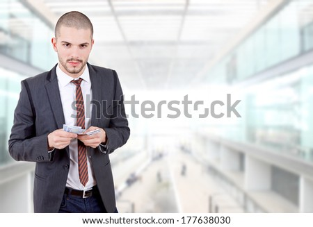 young businessman with money at the office - stock photo
