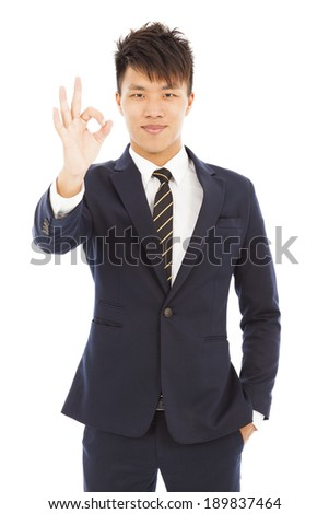 young businessman with ok gesture - stock photo