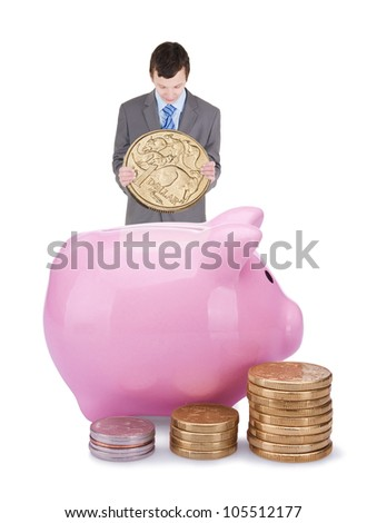 Young businessman with pigggy bank isolated on white background