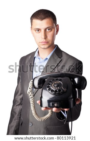 young businessman with retro telephone isolated on white background - stock photo