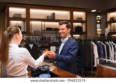Young businessman with seller at checkout - stock photo