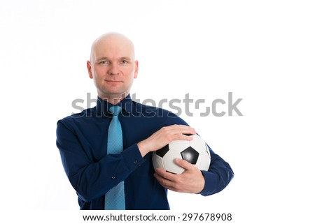 young businessman with soccer ball under his arm - stock photo
