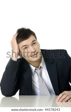 Young businessman with stress headache - stock photo