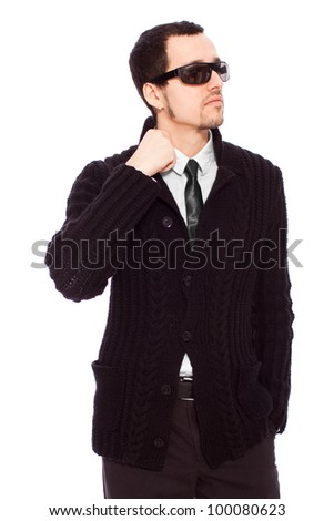 Young businessman with stylish sunglasses and hand in pocket