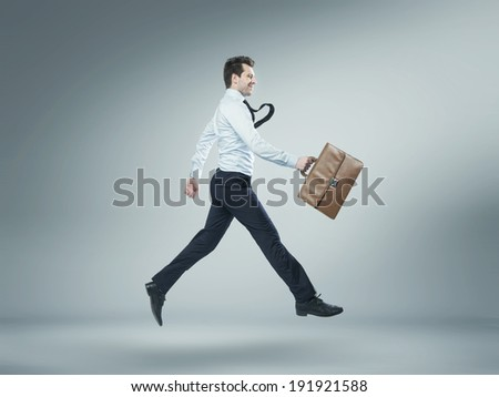 Young businessman with suitcase - stock photo