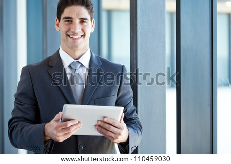 young businessman with tablet computer in office - stock photo