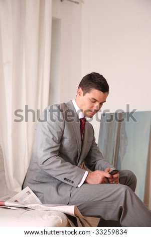 young businessman with telephone - stock photo