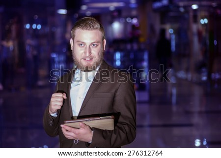 young businessman with the tablet