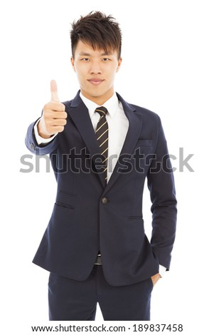young businessman with thumb up gesture - stock photo