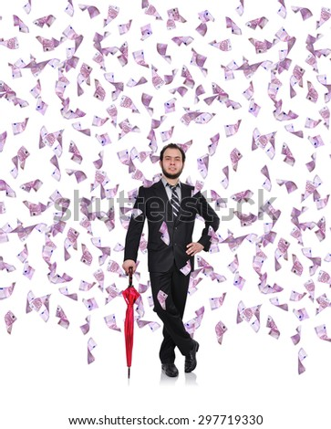 young businessman with umbrella and flying euro bills - stock photo