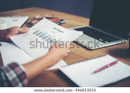 young  Businessman woman hands reviewing analyzing financial data chart.  - stock photo