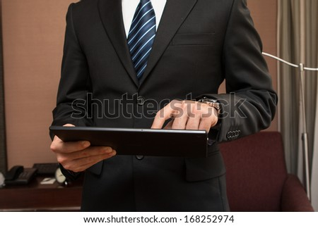 Young businessman working by using tablet.