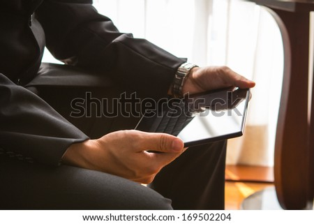 Young businessman working by using tablet.  - stock photo