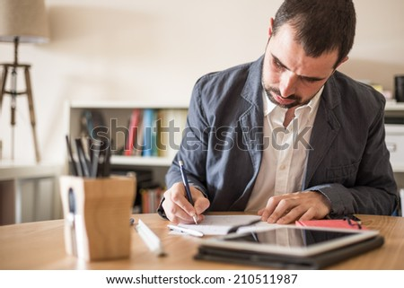 Young businessman working in his modern office.