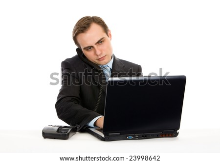 Young businessman working on a laptop. Isolated on white.