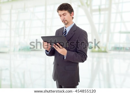 young businessman working with a tablet pc, at the office - stock photo