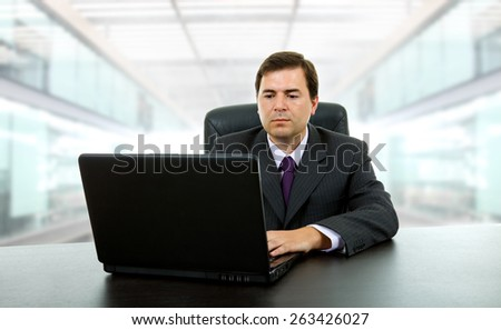 young businessman working with is laptop at the office