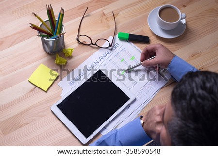 Young businessman working with modern devices, digital tablet computer - stock photo