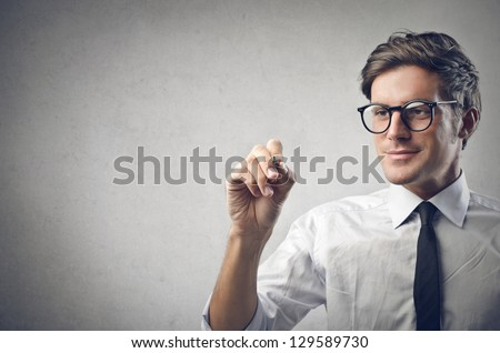 young businessman writing - stock photo