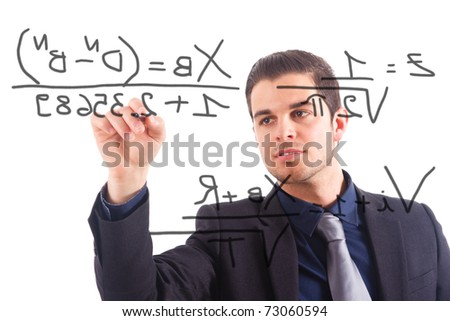 Young businessman writing math formulas on the screen. - stock photo