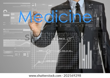 Young businessman writing medicine concept - stock photo