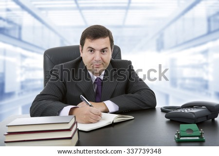 young businessman writing on a desk, at the office - stock photo