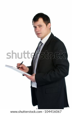Young businessman writing on clipboard.