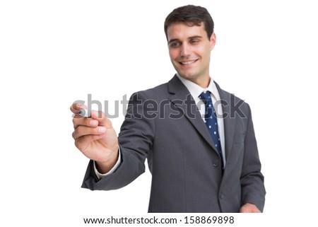 Young businessman writing something on white background - stock photo