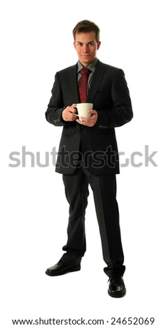 Young businessmen holding a cup of tea isolated on white