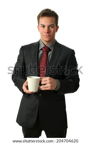 Young businessmen holding a tea cup isolated on white - stock photo